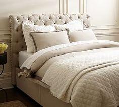 Chesterfield upholstered headboard & storage platform bed, $1,049-$2,299 | Pottery Barn
