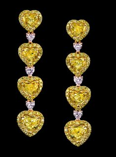 Robert Procop Exceptional Jewels: The earrings are handcrafted in Yellow Gold, each earring holding four Yellow Heart Shape Diamonds for a total weight of and three each of Pink Heart Shape Diamonds for a total carat weight. Heart Jewelry, Diamond Jewelry, Diamond Earrings, Fine Jewelry, Women Jewelry, 4 Diamonds, Colored Diamonds, Yellow Diamonds, Pink Sapphire