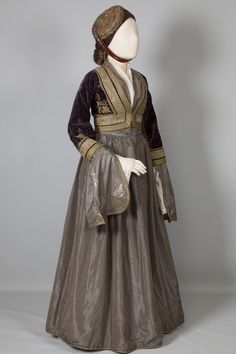 "Greece, ""Amalia"" costume, late 19th century. The arrival in Greece of Queen Amalia in 1837 is a turning point in Greek costume history. Amalia created a romantic part-Greek, part-Viennese costume, known as the Amalia Costume. Peloponnesian Folklore Foundation, Nafplion"