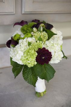 Wedding bridal bouquet made at Greenlife Grocery in Asheville with hydrangeas, button mums, green ball dianthus, dahlias, alstromeria and callas