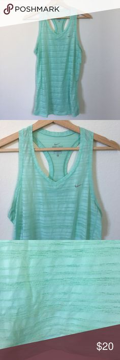 { Nike } dry-fit Racerback tank top Nike dry-fit racer back tank top, v neck, sheer, never worn but has a mild marking on lower front (see picture very hard to see) in great condition otherwise. Super cute go to. Nike Tops Tank Tops