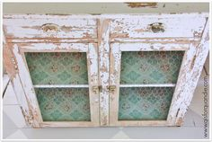 Gorgeous old cabinet with chicken wire and vintage aqua and pink wallpaper (Q is for quandie)