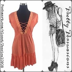 NWT Free People Coral Embroidered Tunic Dress NWT Free People Coral Corset Laced Embroidered Tunic Dress  MSRP $98.00  Size: Large Measurements available upon request   Features:  • corset styled lace up front • plunging deep v-neckline  • ruffled bottom hemline • embroidered detail  • soft material; has stretch  • short sleeves  Bundle discounts available  No pp or trades Free People Tops Tunics