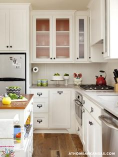 Another bright kitchen. Imagine the window on the right wall. The floor to ceiling cupboards straight ahead could cover the door to the shop, which could be removed at a later time if desired.... or even attached by hinges for 'hidden' access.