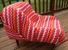 """This Lavish Loungers is made from an """"upcycled expired car seat"""" using a thick canvas fabric (tangerine/strawberry/wine/white chevron fabric), its washable and very durable. Can only be spot washed as the material is attached to the lounger. It's perfect for a small dog/cat bed or the perfect little Lounger for a Toddler or Child!  Price $150.00.  if you would like it shipped, please contact me for shipping costs."""
