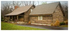 Concrete Log Siding. Would love to redo the outside of our home with this! Would go well with our metal roof!