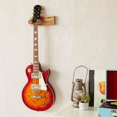 Personalised Guitar Stand And Plectrum Holder By Mij Moj Design | notonthehighstreet.com Guitar Wall Stand, Guitar Wall Hanger, Guitar Display, Acoustic Guitar Chords, Guitar Songs, Guitar Diy, Types Of Guitar, Gift For Music Lover, Wooden Gifts