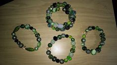 I had a bunch of green beads sitting around here forever.   So I decided to use them up.   I made one memory wire bracelet and 3 stretchy bracelets.