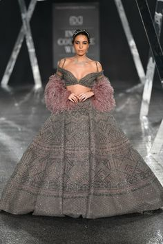 'BONJOUR AMER' showcased at the India Couture Week, . Dark mauve hued lehenga with grey embroidery, teamed with a deep-neck cropped… Indian Gowns Dresses, Indian Fashion Dresses, Dress Indian Style, Indian Designer Outfits, Bridal Dresses, Indian Designers, Indian Bridal Outfits, Indian Bridal Fashion, Bridal Lehenga Collection