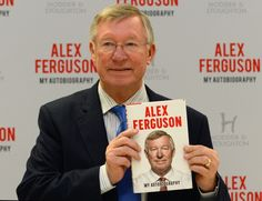 Former Manchester United manager Alex Ferguson poses for pictures with his new book 'My Autobiography' before a signing in a supermarket in Manchester, northwest England, on October 24, 2013. Ferguson launched his new autobiography, lifting the lid on his relationships with stars such as David Beckham, Cristiano Ronaldo, Roy Keane and Wayne Rooney