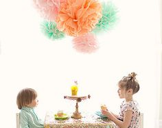 BETH COLLECTION: SET OF 5 TISSUE PAPER POM POMS + SET OF 8 RAINDROP GARLANDS  COLORS IN THIS COLLECTION: -White pom poms - 2 pink raindrop garlands - 2 orange raindrop garlands - 2 blue raindrop garlands -2 yellow raindrop garlands  WHATS INCLUDED: This package includes: 3- large pom-poms (approx. 17 in diameter) 2- small pom- poms (approx. 11 in diameter) 5 yards of monofilament for hanging EIGHT 5 raindrop garlands- colors as pictured Blooming instructions  WHAT YOU NEED TO TELL ME IN THE…