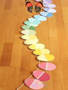 12 easy Easter crafts for kids - Today's Parent 12 easy Easter crafts for kids | Todays Parent<br> Try these easy Easter crafts for kids and fill your house with homemade eggs, bunnies, chicks and more signs of spring. Paint Chip Mobile, Paint Chip Wall, Paint Chips, Paint Swatch Art, Paint Swatches, Easter Garland, World Crafts, Tissue Paper Flowers, Paint Samples