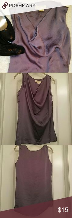 MICHAEL KORS SLEEVELESS TOP Michael Kors sleeveless tunic with scoop neck Never worn/ excellent condition S/P Smoke free/pet free home Hand wash 100% polyester Michael Kors Tops Tunics