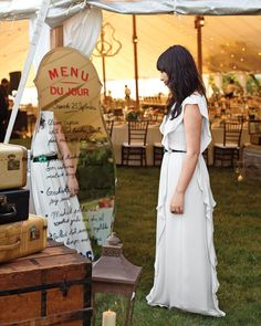 The menu at Lilly and Charlie's homespun DIY wedding was displayed on a…