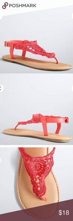 Torrid Coral Crochet T-Strap Sandals size 12W Up for grabs is this pair of wide width sandals from Torrid. They are a size 12W and have flat soles. These sandals are thong style with behind the ankle straps. They are coral colored with a crochet panel that lays on top of the foot. These sandals have faux leather straps and a buckle closure. They are new with the original tag. *These sandals sold in the store without a box, so no box is included.* torrid Shoes Sandals