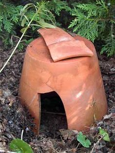 toad abode -an other pinner says.. you can make your own w/a broken pot, and they WORK... mine always have toads in them!