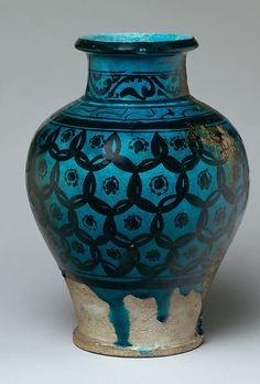 Late 12th-early 13th c. Raqqa, Syria stonepaste painted underglaze with transparent turquoise glaze (H 11 1/2 x dia. 8 1/4 in.) - Met Museum 56.185.15