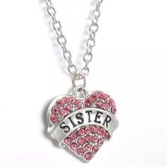 Sister NecklacE Cute silver toned zinc alloy necklace. Chain is about 25 inches. This has a chain extender and lobster clasp. New in package. This has pink rhinestones. Makes a great gift! Jewelry Necklaces