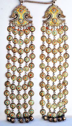 """Super long and elaborate chapan (=ceremonial coat) ornaments made of gilt silver with all over granulation and turquoise inlay. While probably made in the Caucasus, they seem to feature a special design intended for Uzbekistan or Kazakhstan. From Linda Pastorino on Pinterest, via the FB page """"Ethnic Jewellery and Adornment"""". (Joost Daalder)"""