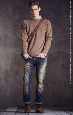 Effortless. Brown sweatshirt, light coloured shirt over washed denim