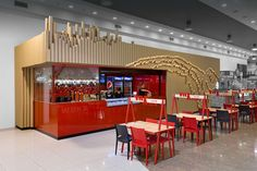 Designers used brown kraft tubes and LED lights to give this fast food restaurant its own identity
