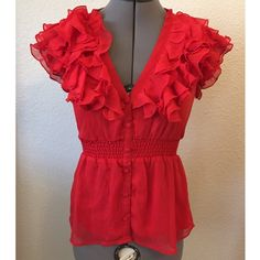 Dressy H&M Top Dressy H&M Top. Vibrant Orange/Red Color. Lined with a silky material. Extra button still attached to inside tag. EUC. H&M Tops Blouses