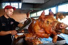 """One of my favorite memories of Puerto Rico was ordering two pounds of """"lechon asado"""" from a roadside lechonera.  Amaaaaaazzziiiiing!  even though I didn't have enough Spanish under my belt to tell him what part of the pig I wanted.  I had to point.  At myself."""