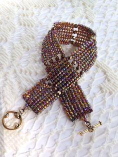 Deep amber and bronze herringbone stitch beaded bracelet by BeadALittleDream on Etsy https://www.etsy.com/listing/189101328/deep-amber-and-bronze-herringbone-stitch