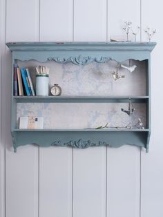 Decorative Shelf - An elegant statement piece for any room, this pretty shelf features unusual carved detailing, a slightly distressed paint finish and is lined with lovely blue and green damask paper. £135.00