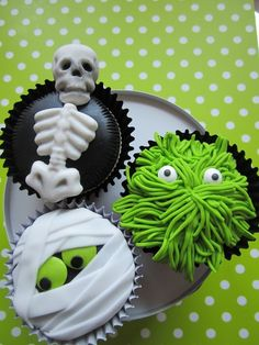 Very Cute Halloween Cupcakes! love the monster one...would be super easy to do w/the grass tip!