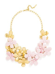 LOVE, LOVE, LOVE!!!: Gold and pink blooms on this bib have a throwback '70s feel that we're super into.