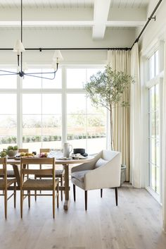 Dining rooms don't get much dreamier than this. We love how airy and elegant our Tailored Pleat Drapery looks in Studio McGee's stunning home.  #diningroom #studiomcgee #diningroomdecor #interiordesign