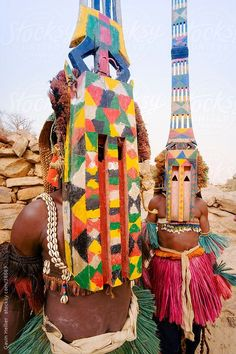 Africa, West Africa, Mali, Dogon Country, Bandiagara escarpment, Masked Ceremonial Dogon Dancers near Sangha by GHProductions   Stocksy United: