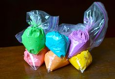 Bags of colorful rainbow frosting.