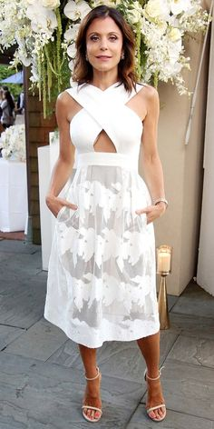 Bethenny Frankel attended the B Floral Cocktail Hour in a Hamptons-ready look: a white cutout dress with a semi-sheer skirt, nude heels, and a simple metallic bangle. Celebrity Moms, Celebrity Outfits, Celebrity Style, Celebrity Photos, Bethenny Frankel, White Halter Dress, Keyhole Dress, Skinny Girls, Cutout Dress
