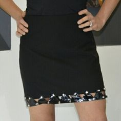 "REDUCED💋HP💋Fumblin' Foe black mini skirt NWOT Brand new no tags  Goregous and Edgy little black mini skirt. Details around the bottom of this skirt add a touch of sass!  Pair with a sassy top and heels!   Skirt: 100%polyester (no material tag) Bottom details:Vinyl like material with silver studs. Size medium Zipper on the side Length  16"" Waist approx  16"" side to side/approx 32"" all the way around.  💗No trades 💗Price is firm Fumblin' Foe Skirts Mini"