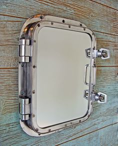 an authentic shipu0027s porthole window recycled from the shipping industry that weu0027ve repurposed into an impressive nautical mirror