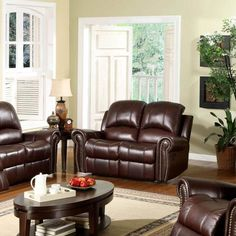Features:  Design: -Reclining.  Style: -Traditional.  Frame Finish: -Burgundy.  Upholstery Color: -Burgundy.  Frame Material: -Wood.  Upholstery Material: -Genuine Leather.  Hardware Material: -Stainl