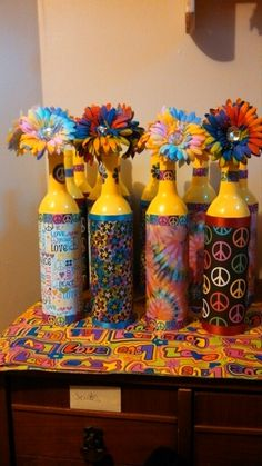 Desert Lily Vintage Party idea for party Spray paint wine bottles add scrap booking paper and ribbon Hippie Party, Hippie Birthday Party, 60th Birthday Party, Geek Birthday, Birthday Brunch, Birthday Presents, Birthday Ideas, 60s Party Themes, 60s Theme