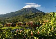 Arenal, Costa Rica. We visited here and spent the day in a hot springs bath heated by the volcano. Amazing!