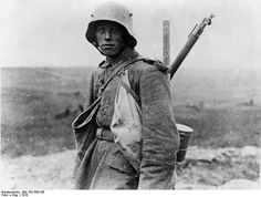 This is a photograph of a young German soldier engaged in the Battle of the Somme, 1916. He wears a helmet, so the photo is from late in 1916.