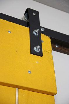 """hardware and handy """"advice"""" for hanging barn door  http://www.housetweaking.com/2011/02/13/diy-sliding-barn-door-part-ii/"""