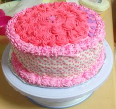 rose designed vanilla cake with cream cheese whip cream frosting.. sory i dont have that smooth finish coz its my frst time making this cake :-)