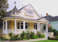 sweet house. I love everything about this house, front porch, yellow paint and grey roof, perfect by corinne
