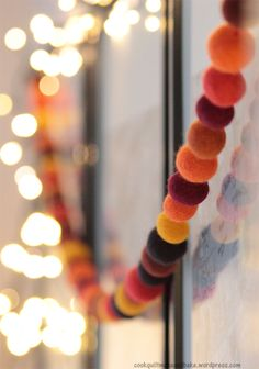 DIY: felted ball garland - use white balls (various sizes) and hang vertically to look like falling snow