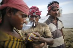 The Ship Breakers - In Focus - The Atlantic Workers smoke a cigarette during a break at a ship-breaking yard in Chittagong, Bangladesh, on July 16, 2013. (Reuters/Andrew Biraj)