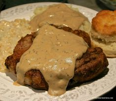 country fried pork chops & gravy ***made 4/19/16... these were amazing. we used 4 smaller pork chops so I only baked in the oven for about 6-7 minutes. Also, only used 2 cups milk and forgot the sour cream.