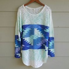 ✨HP✨  BOUTIQUE tunic Fun print boutique tunic. Features oversized fit, drop sleeves, long sleeve, crew neckline, u shaped bottom hem, tribal print in middle of body and bottom part of sleeves. Colors include shades of blue, green, and purple.  I wore this as a cover up to the beach as it is see through. Washed and wore once and in great condition. No tag at top but material and size tag are attached at side. 96% polyester 4% spandex. Boutique Tops Tunics