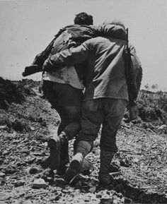 A wounded US Marine being helped off the field, Okinawa 1945
