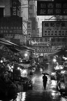 This photo by Kit Lam shows a down town street in Hong Kong, China. The once busy street at day time, quickly becomes empty by night; I believe this is a really well documented image.
